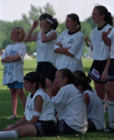 7/13/97--SOCCER--DAN  CAPPELLAZZO PHOTO--MEMBERS OF THE NIAGARA PIONEER COUGARS UNDER 16 GIRLS REACT AFTER LOSING THE CONSOLATION GAME AFTER A 1-1 TIE FORCED THE GAME TO BE DECIDED BY PENALTY SHOTS.<br /> <br /> SPORTS