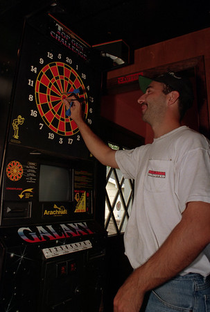 98/07/30  Darts *Dennis Stierer Photo -<br /> Glen Klumpp chekcs his score and retreives his darts at a game at Pleasant Valley Tavern.