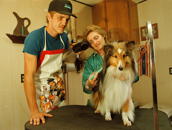 10/2/97- Canine Care--Takaaki Iwabu photo-- Robert and Denise Josey are owners and operators of Canine Care Center on 3520 Coomer Rd. in Newfane. <br /> <br /> money, bw, Friday