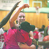2/20/96--NF high basket 1--Takaaki Iwabu photo--                          ........., gets a hug and high five at center court after the game as Power Cats celebrate the victory.