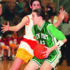 2/24/97--GIRLS HOOPS COLOR--DAN CAPPELLAZZO PHOTO--LEWPORTS MEGHAN HOUSE DRIVES AGAINST WILLIAMSVILLE-EASTS  KRISTIN SCHUMACHER IN 3RD QUARTER ACTION.<br /> <br /> SP