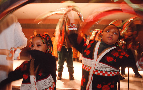 2/23/97-- black history--Takaaki Iwabu photo-- Ashley Hasley, 6, and Dominique Miles, 8, perform with other children and choir members during the cultural program which celebrates black history month at Family Resource Center Sunday. <br /> <br /> 1a sunday color