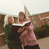 "98/03/02--ST TERESA'S--DAN CAPPELLAZZO PHOTO--PUBLICITY CHAIR FOR THE ""MAGNIFICAT""  JUDY SEARS , OLCOTT, AND MAGNIFICANT MEMBER FRANCINE WROBLEWSKI, NEWFANE, CHECK OUT THE GOOD BOOK IN FRONT OF ST TERESA'S CHURCH ON COLLEGE AVE.<br /> <br /> SATURDAY FEATURE"