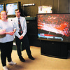 2/4/97--OJ VERDICT--DAN CAPPELLAZZO PHOTO--(FRONT TO BACK) ANTHONY AMATO SPEAKS WITH FELLOW EMPLOYEES CARLA CARAPEZZA AND JOHN CZECH ABOUT THE OJ VERDICT AS THEY WATCH THE COVERAGE IN THE ELECTRONICS DEPT OF SEARS, SUMMIT MALL.