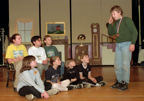 98/04/03 Story Tellers *Dennis Stierer photo - All these children were winners at the Storytelling Festival. As Cory Wilson tells his story, the others watch his technique. Those listening are as follows: Sitting on floor from left are Natalie Simons,  Megahan Phipps,  Christie Young,  and Jaclyn Dent. Sitting on the bench from the left are Alix Krzemien,  Arlee Logan,  and Jeff Hass.<br /> See also attached sheet about festival.