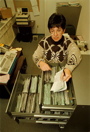 98/11/04 Ticket Amnesty 2 - James Neiss Photo - Michele Etopio, Account Clerk for the City of NF Controllers office, shows off unpaid parking tickets that are taking up space in over 4 drawers.