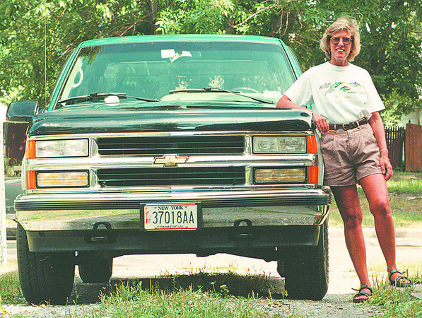 8/12/97--TRUCK LADIES--DAN CAPPELLAZZO PHOTO--LORI HILLMAN, OF 59TH STREET, STANDS WITH HER FULL SIZE CHEVY 1500 SILVERADO.<br /> <br /> SUNDAY FEATURE