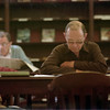 98/05/04 Rainy reader-Rachel Naber Photo-Bruce Giles (right) spends a quiet moment reading at the Lockport Public Library as the rain outside continues to fall.