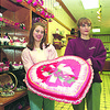 2/11/97--VALENTINES DAY--DAN CAPPELLAZZO PHOTO--(LTOR) STACY LaBARBER AND GWYN PATRICK OF ROCKEY MNT. CHOCOLATE HOLD A HUGH CHOCOLATE HEART FOR VALENTINES DAY.