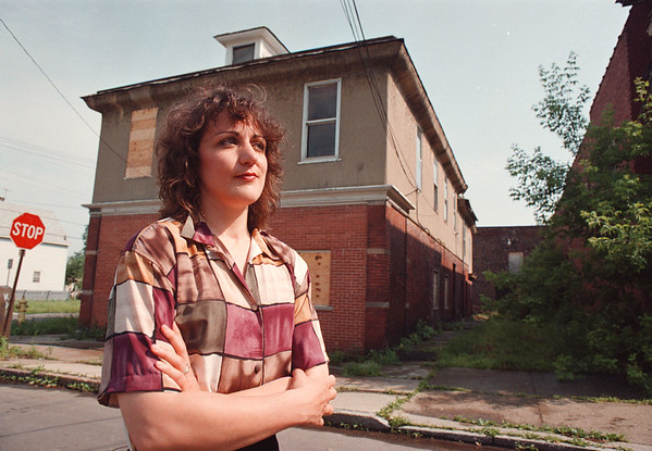 6/24/97-- revitalization--Takaaki Iwabu--Carolyn Van Schaik, executive director of Center City Neighborhood Development Corp, stands in front of the building on corner of 15th St. and Linwood Avenue, the area which will be revitalized. <br /> <br /> 1A, Wednesday, color