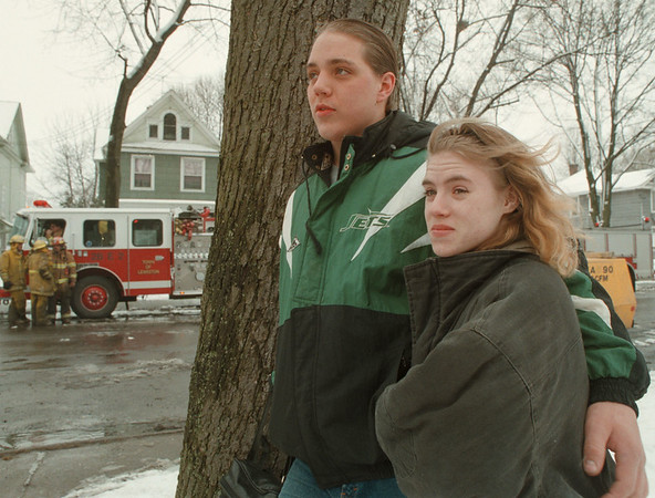 98/03/14-- fire 2--Takaaki Iwabu photo-- William Perdue of 1637 Niagara Ave. looks on the City workers investigate the fire scene with his girlfriend Mary Wallace. (Perdue's house was managed to escape fire... )