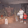 97/10/22--SUMMIT/HAUNTED HOUSE--DAN CAPPELLAZZO PHOTO--LENNY MICELI AND HIS 7-YR-OLD SON JOEY, OF WHEATFIELD, WALK THROUGH THE HAUNTED HOUSE  AT THE SUMMIT MALL.<br /> <br /> GRAPE