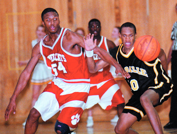 2/10/97--LASALLE/NF BASAKETBALL--DAN CAPPELLAZZO PHOTO--NF CLEVELAND SPENCER (#54) AND LASALLE'S NATE MERCHANT (RIGHT) BATTLE FOR THE BALL IN FOURTH QUARTER ACTION AT LASALLE HIGH.