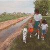 6/11/97 Dirty Ditch - James Neiss Photo - L-R- April Walker 6, a family friend, Jennifer Speier and doughter Kimberly Speier walk along a ditch in there back yard. Chi Chi the family dog came along for a walk.