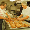 97/09/27 fruit cake--Takaaki Iwabu photo-- Loraine Moeller and Clarice Poerschke, co-chairman of St. John Lutheran Church's Octoberfest, prepare fruit cake at the Church Saturday. <br /> <br /> tmc photo