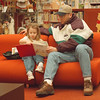 2/18/97 Reading Together - James Neiss Photo - Marisa Shammot 3yrs, reads to her father Justin Shammot durring their weekly outing to the library. Both live on South Ave, NF.