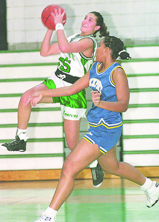 1/14/96-- Girls hoops 2--tak photo-- Lew-Port Toni Mauro jumps for a basket passing Lockport Sadie Taylor.