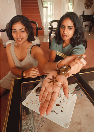 """8/1/97 Henna Tattooing - James Neiss Photo - Amy Mepani 15 of Lewiston and Rekha Trivikram 17yrs of Grand Island give an example of Henna Tattooing. They will be participating at the Lewiston Art Fest as """"Amy and Rekha's Temporary TattoosÓ."""