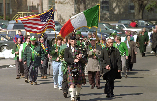 98/03/17 St. Patrick's Parade *Dennis Stierer photo - Leading the parade of AOH friends from St. Patrick's church to the Irish monument is Bagpipe player  Joe Baschnagel.