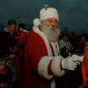 97/12/06--Santa/Lewiston--Takaaki Iwabu photo-- Santa Claus greets children after he arrived by a helicopter in Academy Park in Lewiston Saturday. <br /> <br /> 1A, color