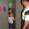 98/09/02 My New Locker *Dennis Stierer Photo -<br /> Kevin Drury, 5 tries out his new locker with his younger brother, David,3 as dad Bob Drury looks on. Kevin starts kindergarden this fall at DeSales Catholic School.