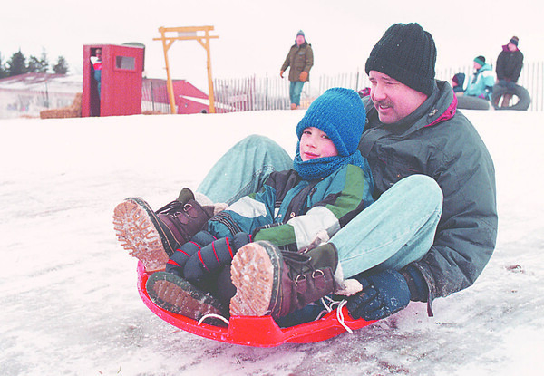 1/23/97 -- snow fest 1--Takaaki Iwabu photo--Dan Lengen of LaSalle rides on the sled with his son Ben, 7, as they visite the Snow Festival at Bonds Lake Saturday. <br /> <br /> Sunday, local