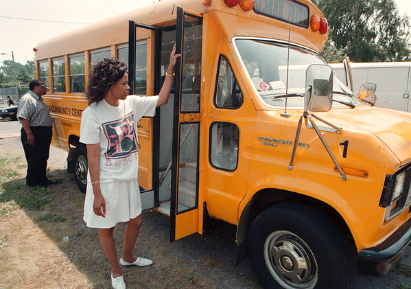 7/14/97--DAMAGED SCHOOL BUS--DAN CAPPELLAZZO PHOTO--RENEE KIMBLE AND PASTOR WILLIAM ROBINSON OF THE COMMUNTIY CENTER , 136 CENTER AVE., LOOK OVER A BUS THAT WAS DAMAGED BY VANDELS BEHING THE COMMUNITY CENTER.<br /> <br /> LOCAL