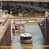 """8/7/97--ERIE CANAL/SUNDAY GRAPE--DAN CAPPELLAZZO PHOTO--VISITORS AT THE ERIE CANAL, LOCKPORT, CHECK OUT BOAT LOADS ON THE """"LOCKVIEW V"""".<br /> <br /> GR"""