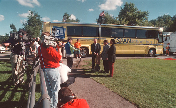 """97/08/18 C-SPAN Visit - James Neiss Photo - The C-SPAN School  bus was parked at Terrapin Point on Goat Island as part of a tour called :  The Alexis De Tocqueville, Exploring Democracy in America. Tocqueville is the French Author of """"Democracy in America.Ó Here, Mayor James Galie and Adelphia Cable Niagara General Manager Vince Laurendi Jr. accept a plaque from Monique Llanos C-SPAN Community Relations Representative."""