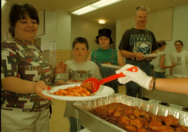 98/05/19--pasta dinner 2--Takaaki Iwabu photo-- Lewsiton-Porter's International Siblings hosted Pasta Dinner Tuesday to raise a fund to send its students to Japan this summer. Getting in line are the Schuberts; from left, Tina, Jeffrey, Sarah and Jeff. <br /> <br /> grapevine photo