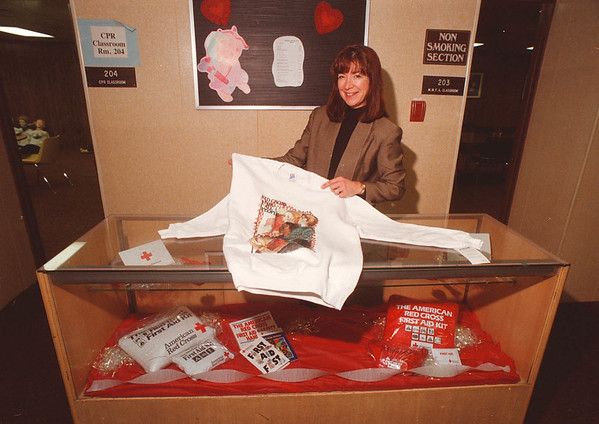 2/11/97 Red Cross - James Neiss Photo - Pat Smith, Director of Marketing at the NF Red Cross, shows off some of the goodies for sale in there Valentine Showcase.