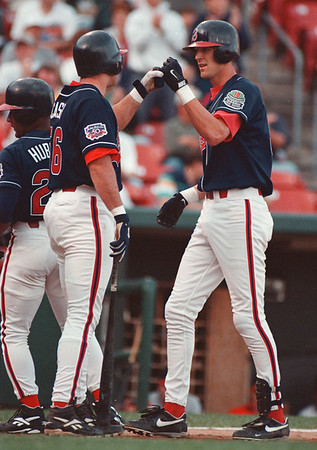 97/08/14-- Bisons 2--Takaaki Iwabu photo-- Bisons' Richie Sexson, right, is greeted by Sean Casey as he comes to home base after he hits a home run during the first game with Indians. <br /> <br /> bw