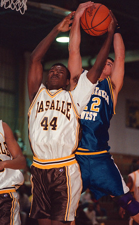 2/21/97- laSalle 2 -- tak photo -- LaSalle's Jason Seaberry fights for a rebound against ................<br /> <br /> sports, Saturday, BW