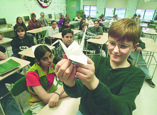 1/3/97 Steven McClinsey Story - James Neiss Photo - Lee Murray 12yrs/7th grade, holds one of over 1200 Origami Cranes he and other class mates made in the memory of Steven McClinsey.