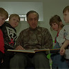98/02/04 Head Start*Dennis Stierer photo -  Phil Barrancotta(?) formerly circulation director at US&J now spends some of his spare time as a foster grandpa with the head start program.  Here he reads to (L-R) Connor Abbott, Joshua Maracle, Samantha Wittcop, and Geoffrey Chamberrlain.
