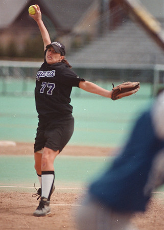 5/2/97--NU softball 2 -- Takaaki Iwabu photo-- Purple Eagles' Patty Cucinato pitches against St. Peter's College during MACC Tournament game. <br />  <br /> <br /> sports, Saturday, bw