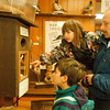 4/19/97-- wildlife 2--Takaaki Iwabu photo-- Jeff Sikora, right, looks at a wood duck nest box with his children Erika, 4, and Ryu, 7, at the display section of open house.