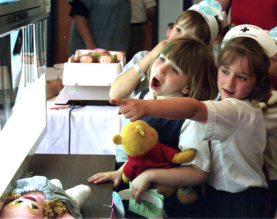98/05/15 Kid Clinic 2-Rachel Naber Photo-Rebecca Mutchok (left) figures out what an x-ray is of with help from her classmate Chelsea Daechler at Lockport Memorial hospital's annual teddy bear clinic