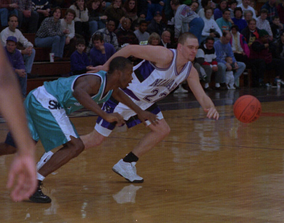 2/8/97 St. Peter's at NU 2 - James Neiss Photo - NU # 22 Brent Beamer chases the ball durring the first half. Niagara University Pruple Eagles Basketball.