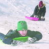 1/18/97-- weather --Takaaki Iwabu photo-- Todd Masterman, 8, North Tonawanda, enjoys sledding on the hill along Williams Road (and River Rd) Saturday with his sister Amy, in back.