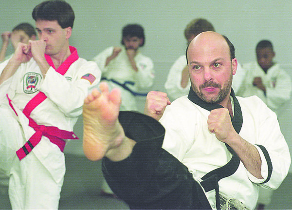 1/15/96-- karate class-- Takaaki Iwabu photo-- John Presti, head instructor at Presti Karate Center on Pine Ave., leads his students during the class for adults Wednesday. (He said he has a mixed feeling on Ultimate Fighting because it does not have any traditional marshall-art style......)<br /> <br /> 1A Friday, color