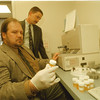 98/02/19 Urine Analysis  - James Neiss Photo - Joseph, H. Claypoole, foreground, a counselor with the Alcoholism Council in Niagara County, Inc.  and  a volunteer urine analyzer at the NFPD, checks the name on a sample which is being analyzed. Randall J. Allan, background,  a MIS Assistant with Health Management Group, Ltd in Buffalo,  works on integrating a Computer and the Analyzer to make reports on results.