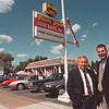 97/08/07--40-YRS-CARS DEALER--DAN CAPPELLAZZO PHOTO--JOE KULIKOWSKI, PRES. & OWNER AND HIS SON KEITH KULIKOWSKI STAND IN FRONT OF THEIR OLIVER STREET AUTO BUSINESS WHICH HAS BEEN OPERATING FOR 40-YRS.<br /> <br /> MONEY PG/SATURDAY