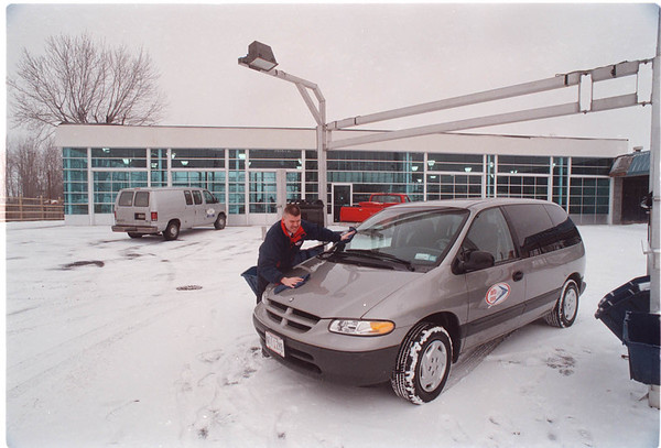 2/12/97 Delta Sonic - James Neiss Photo - Scott Holmes, director of FastLube at the NF Delta Sonic Car Wash drys off his vehical. Just behind him the new Sonic Lube and Detail Shop is still under construction at their NF location. On Niagara Falls Blvd.