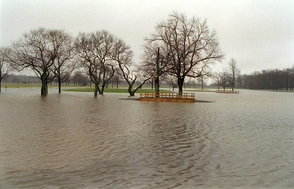 98/01/08 County Golf Flood*Dennis Stierer photo - The County Golf Course on Davison Road seems to be below water as the bridges that go over the creeks seem to be floating on water.