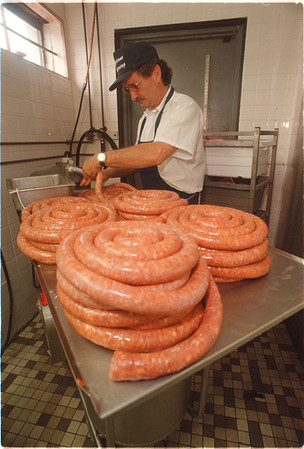97/08/15 Italian Sausage - James Neiss Photo - Richard Scipione of Scipione Bros.  on Pine ave. has been making Italian Sausage all week in preparation for Sundays Italian  Festival.