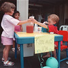 7/28/97--garage sale 2--tak photo-- Timothy Krawczyk, 4, right, gets his own spot to sell Kool Aid to his neighbors Angela and Ashley Deluca.