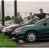 97/09/12 Delia Car Corp - James Neiss Photo - L-R - Tom Kanaley, Sales Manager, Frank A. Delia , President and Patrick Delia General Manager. Deila sells Chevey now.