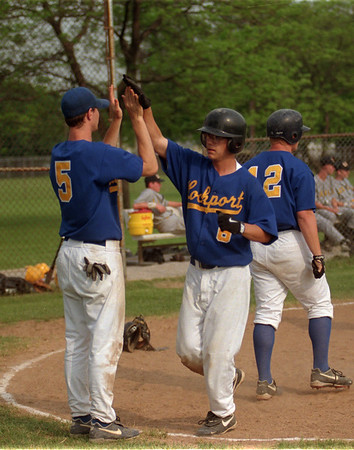 98/05/19 Lockport Baseball - James Neiss Photo - Lewport at Lockport - #5 Brian Mulvey gives #6 Adam Norris a high five as Norris brings in a run in the 2nd inning.