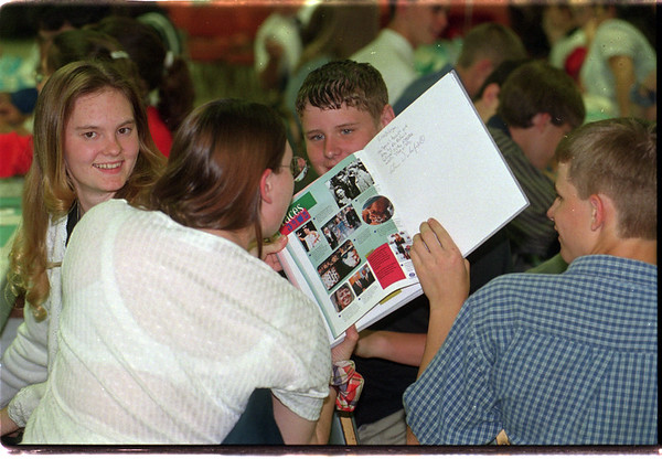 98/06/04 Band Banquet - James Neiss Photo - Band Members look over and sign each others yearbooks durring Band Banquet. L-R are: Julie Tracey 17/11th, Lisa Bellamy 16/11th, Adam Wakefield 15/9th and Matt Rucinski 15/9th.